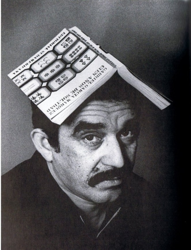"""Gabriel-Garcia-Marquez-with-""""One-Hundred-Years-of-Solitude""""-on-his-head-782x1024"""